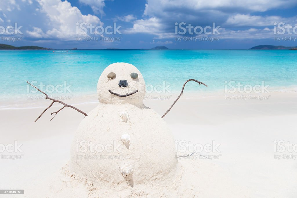 Snowman made of sand at a tropical Caribbean beach stock photo