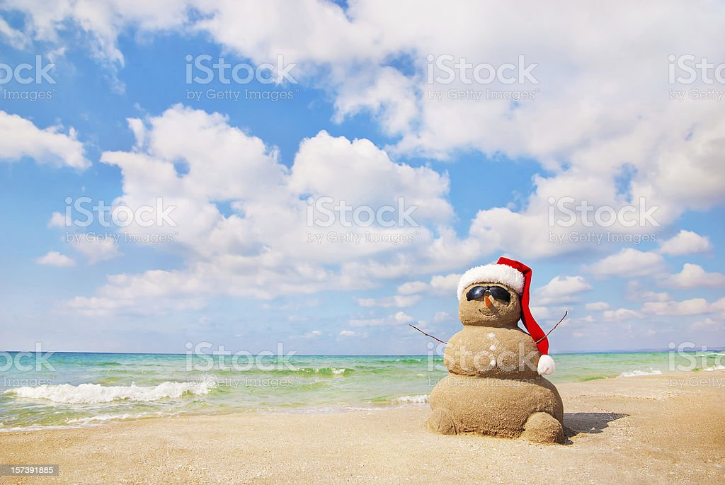 Snowman made out of sand. Holiday concept. stock photo
