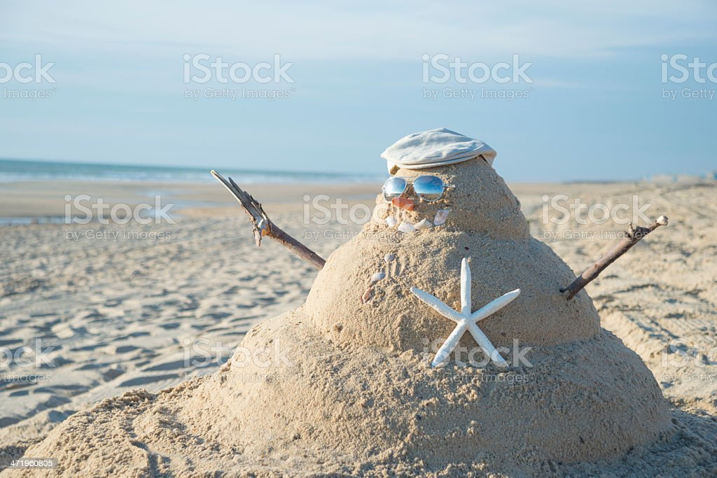 Snowman Made Out Of Sand With Hat stock photo