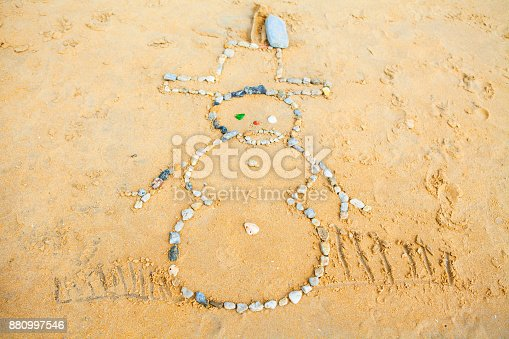 Snowman of rock in  Sand on beach