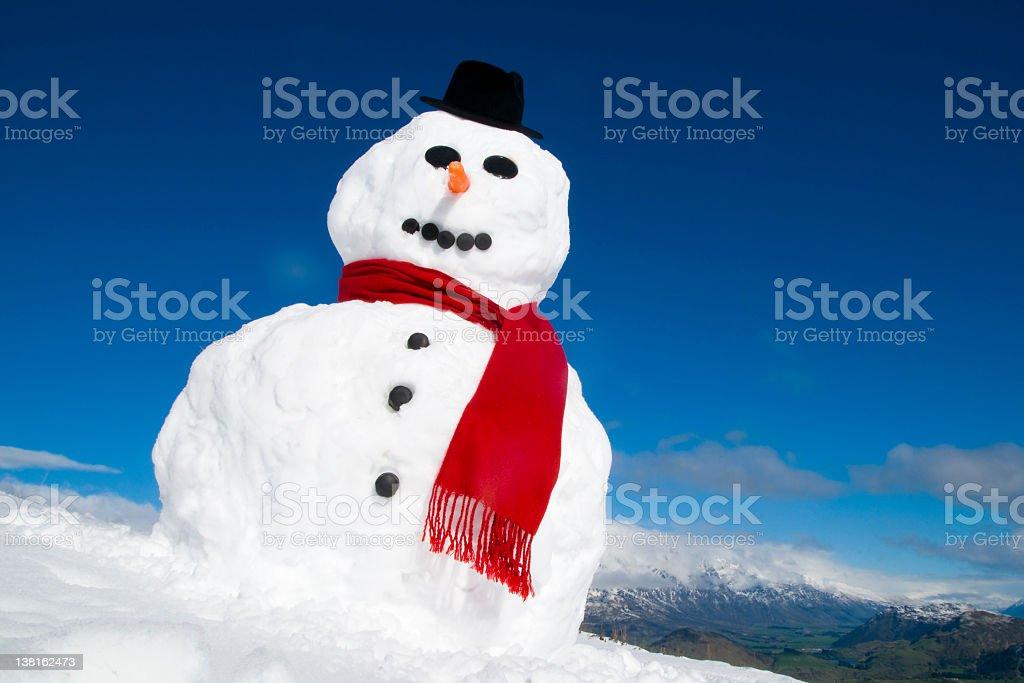 Snowman on a mountain top. royalty-free stock photo