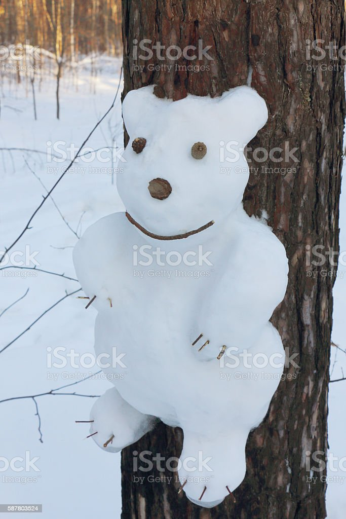 Snowman on a pine  in the form of a bear stock photo