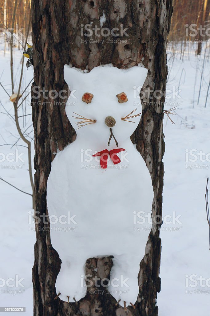 Snowman on a pine  in the form of a cat stock photo