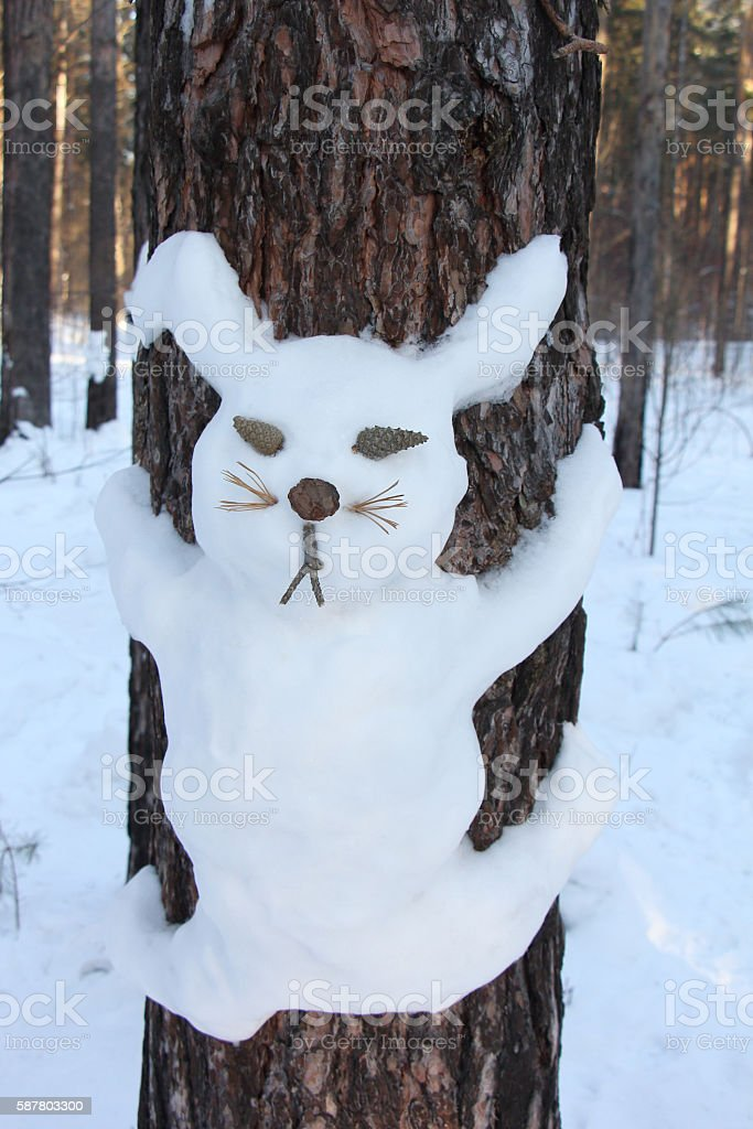 Snowman on a pine  in the form of a hare stock photo