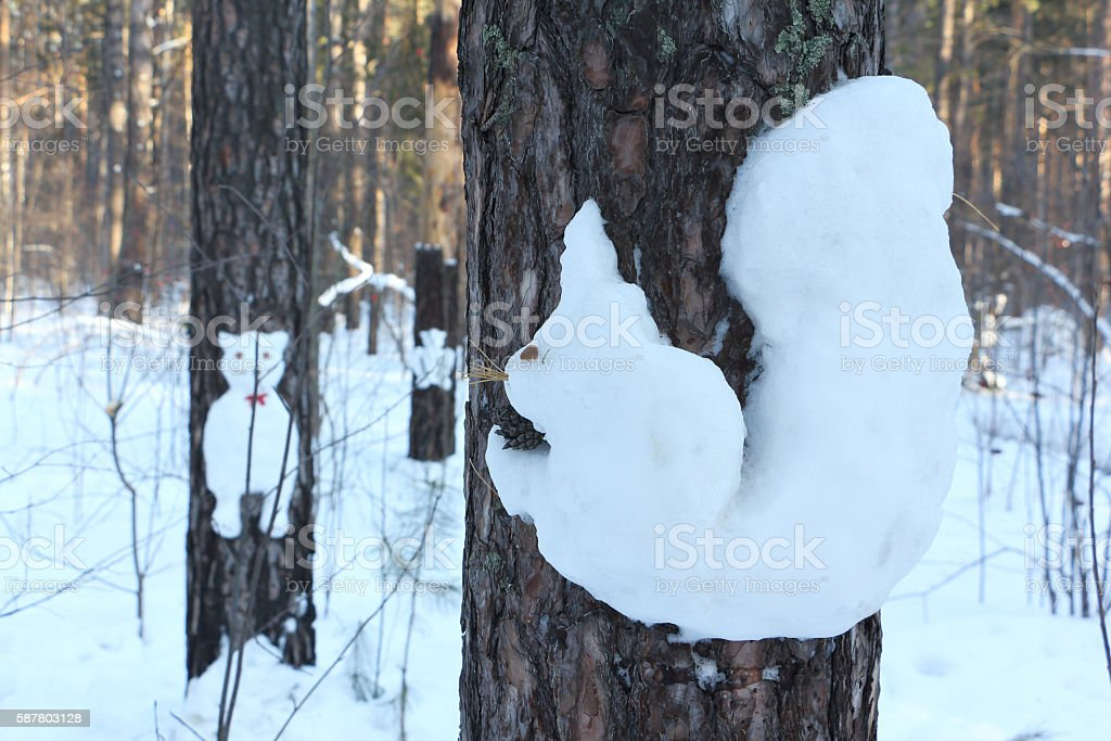 Snowman on a pine  in the form of a squirrel stock photo