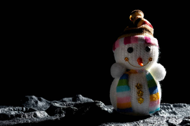 snowman on a planet with craters - lunar new year stock pictures, royalty-free photos & images