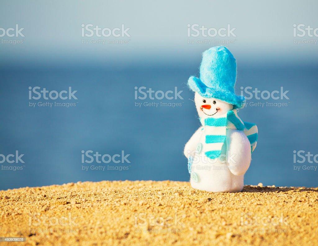 Snowman on sand stock photo