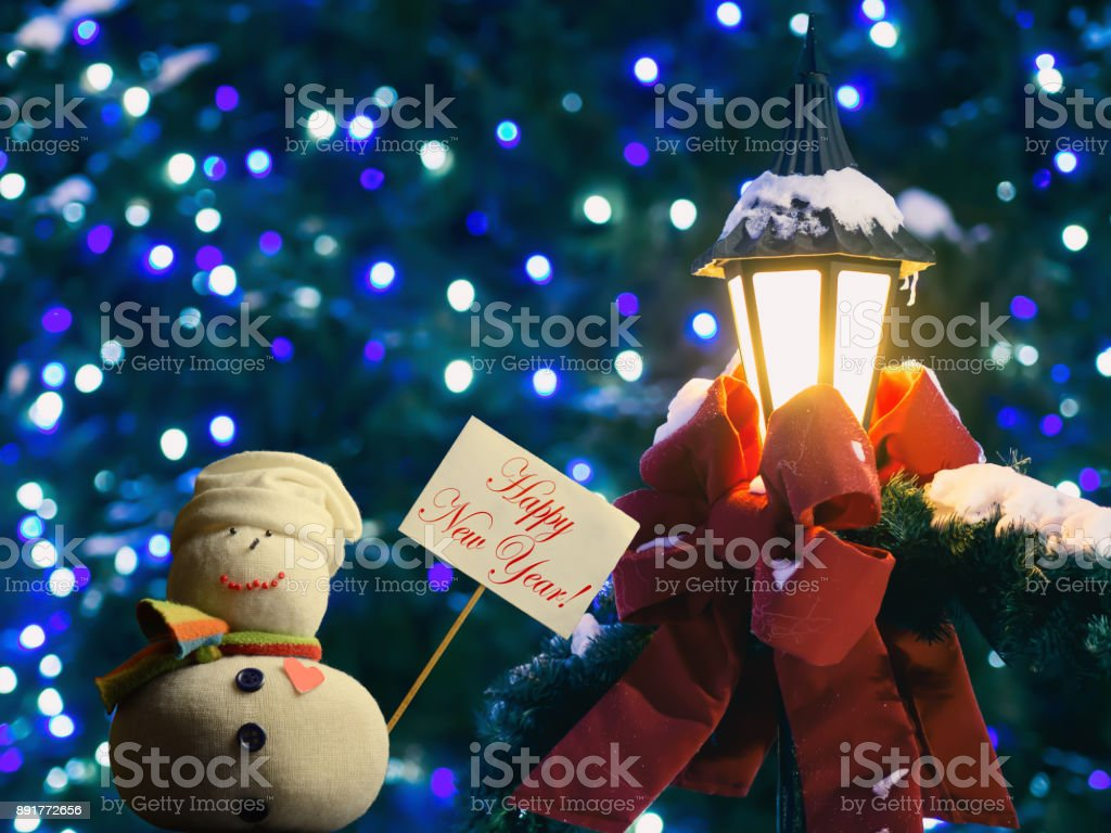 "Snowman, paperboard sign on a stick, text ""Happy New Year!"". stock photo"