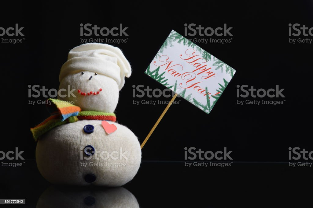 "Snowman, placard board with stick attached, text ""Happy New Year!"" stock photo"
