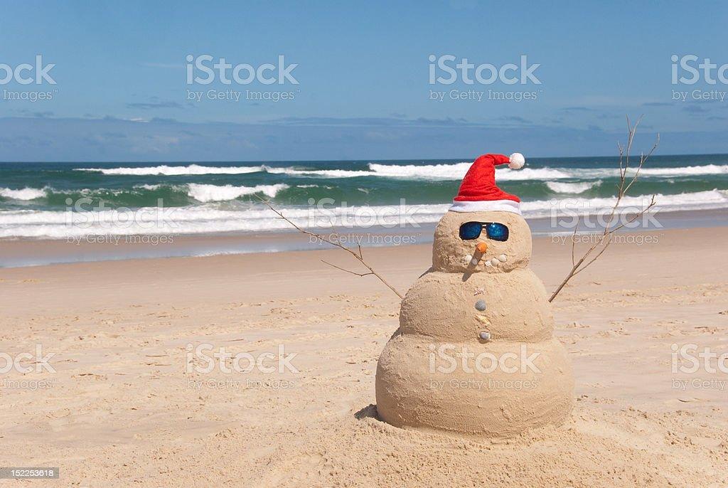 Snowman Resists Melting Process stock photo