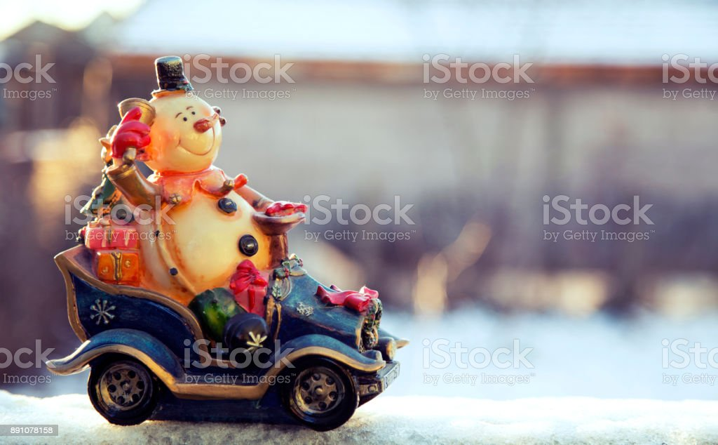 Snowman rides a car with gifts, Happy Holidays background stock photo