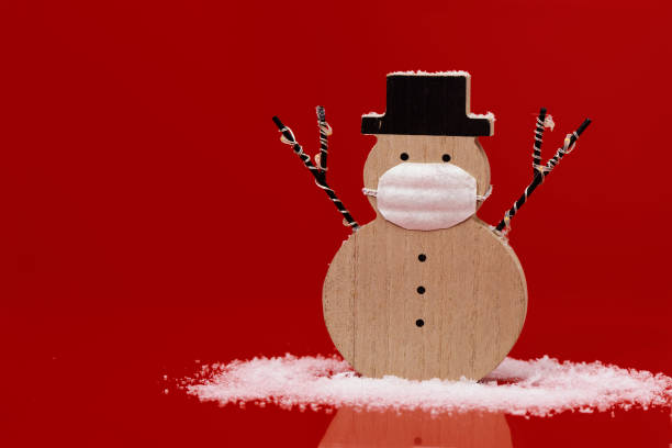 snowman wearing a face mask stock photo