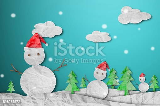 527392693 istock photo Snowman wearing red Santa hat in winter with snow 628289872