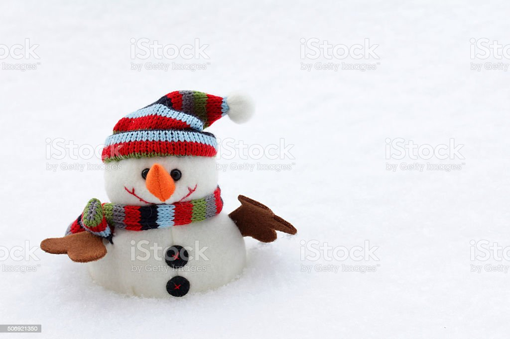 snowman with hat and scarf stock photo