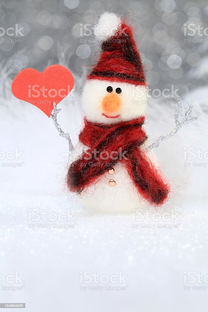 Snowman with heart royalty-free stock photo