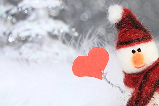 Snowman with red heart stock photo