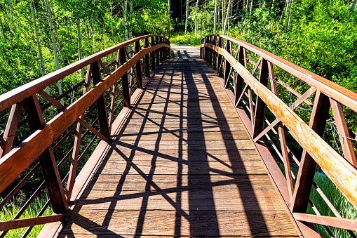 Snowmass village town in Aspen at Brush Creek trail in Colorado downtown with empty wooden bridge closeup and nobody in summer view