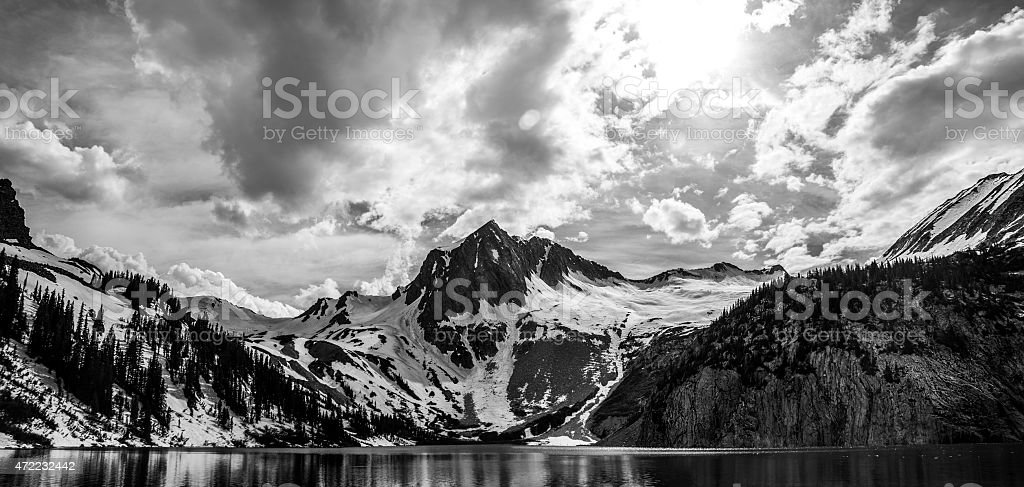 SnowMass Wide Mountains Snow Pack Cliffs Lake Colorado Rugged Summits stock photo