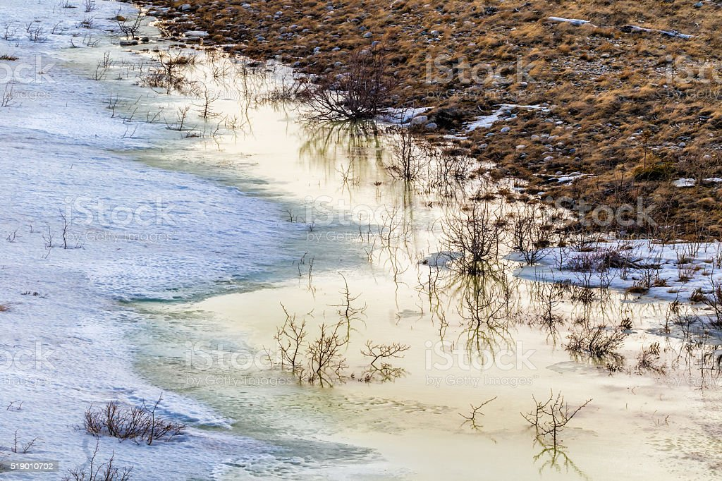 Snowmelt pooling along the Delta River stock photo