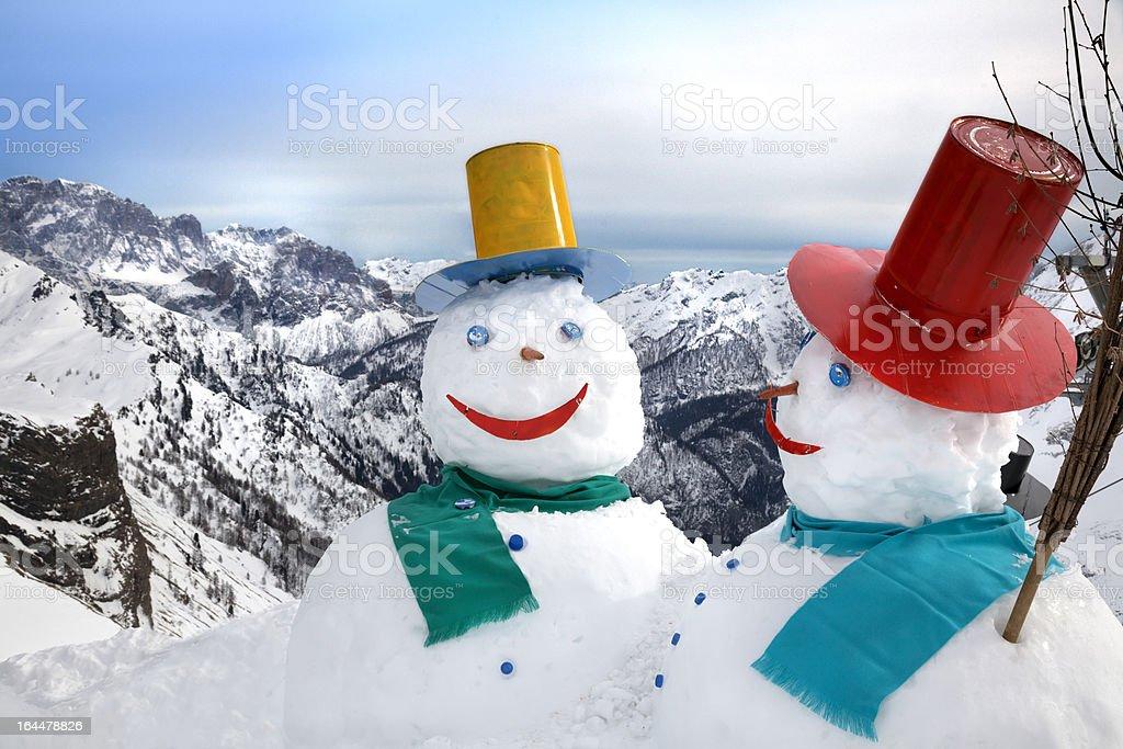 Snowmen in the mountains royalty-free stock photo
