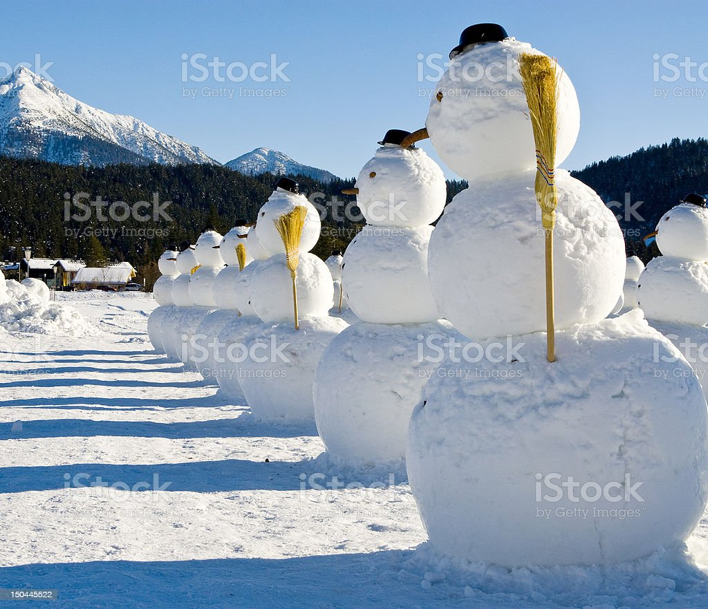 Snowmen soldiers lined up during the middle of winter royalty-free stock photo