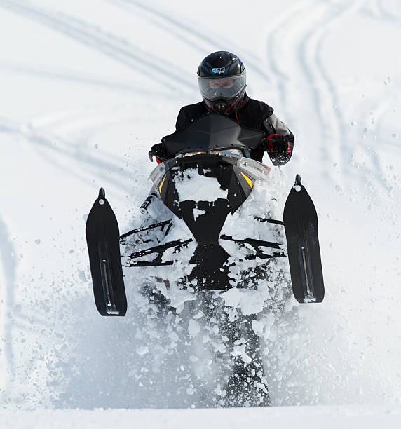 Snowmobile driving. stock photo