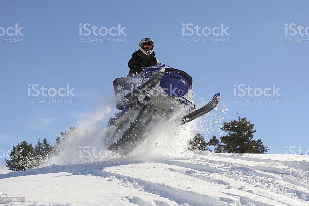 snowmobile high jump stock photo