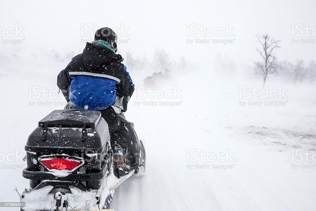 Snowmobile in Blizzard stock photo