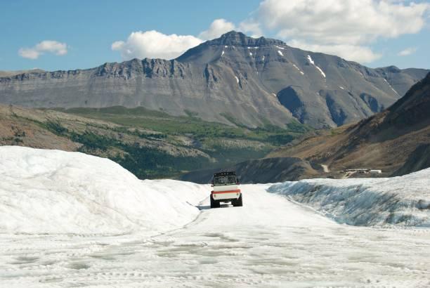 Snowmobile on Athabasca Glacier stock photo