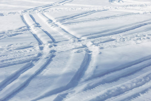 Snowmobile Tracks Stock Photo - Download Image Now - iStock