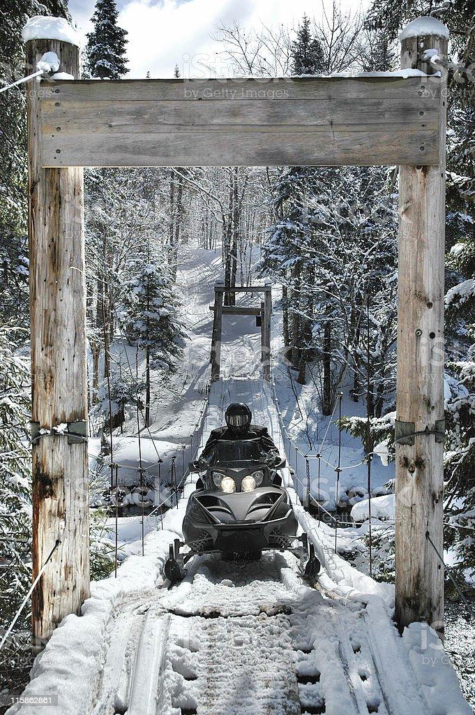 Snowmobiler on Bridge royalty-free stock photo