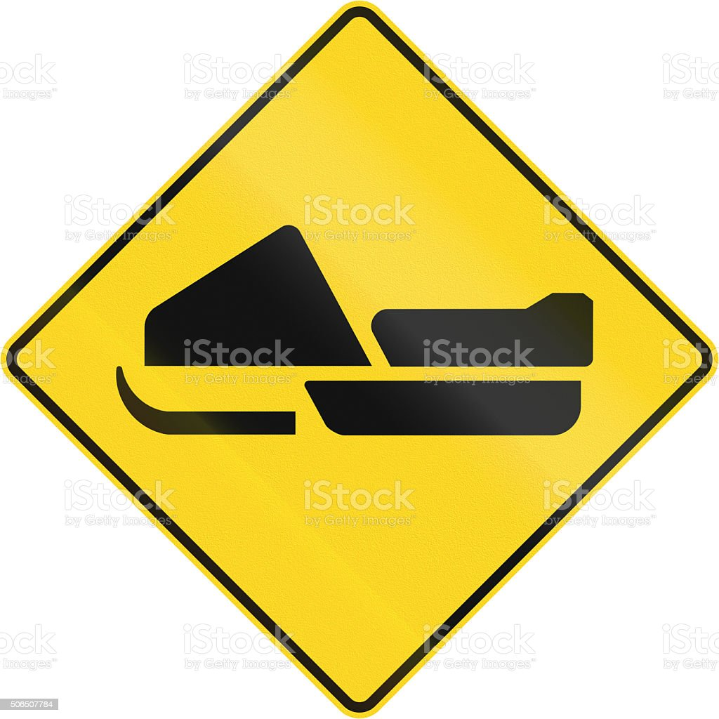 Snowmobiles Crossing in Canada stock photo
