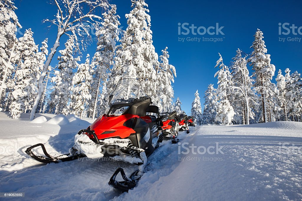 Snowmobiles in snowy Finland stock photo