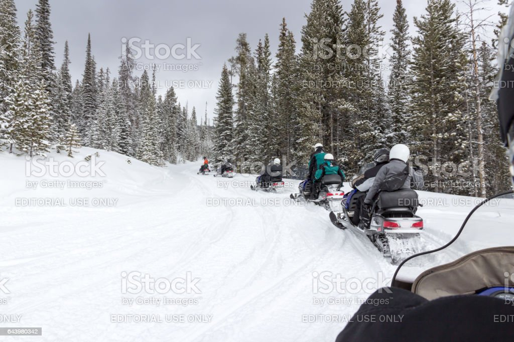 Snowmobiling in Rocky Mountain National Park stock photo