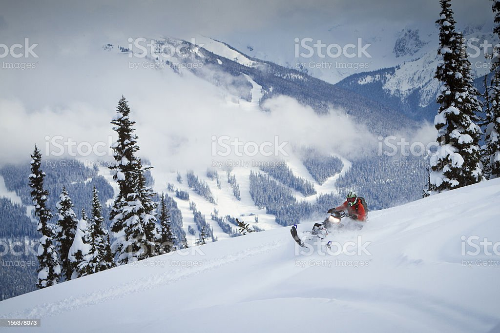 Snowmobiling on the top of the snowy mountain royalty-free stock photo