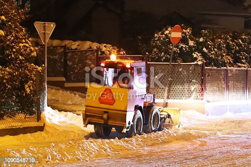 istock A snowplow cleans snow in the evening city. Fighting the winter element in the cold season. Mechanical cleaning of streets from snowdrifts. Difficulties in traffic. Slippy road. The work of municipal 1090548710