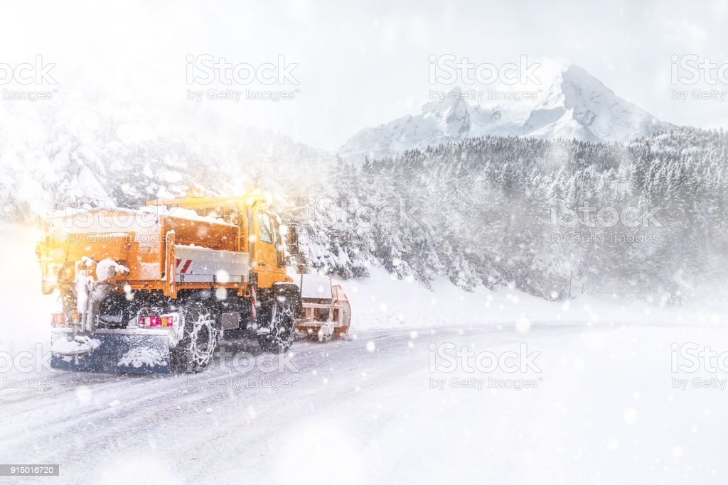 Snowplow cleared the snow-covered icy road stock photo