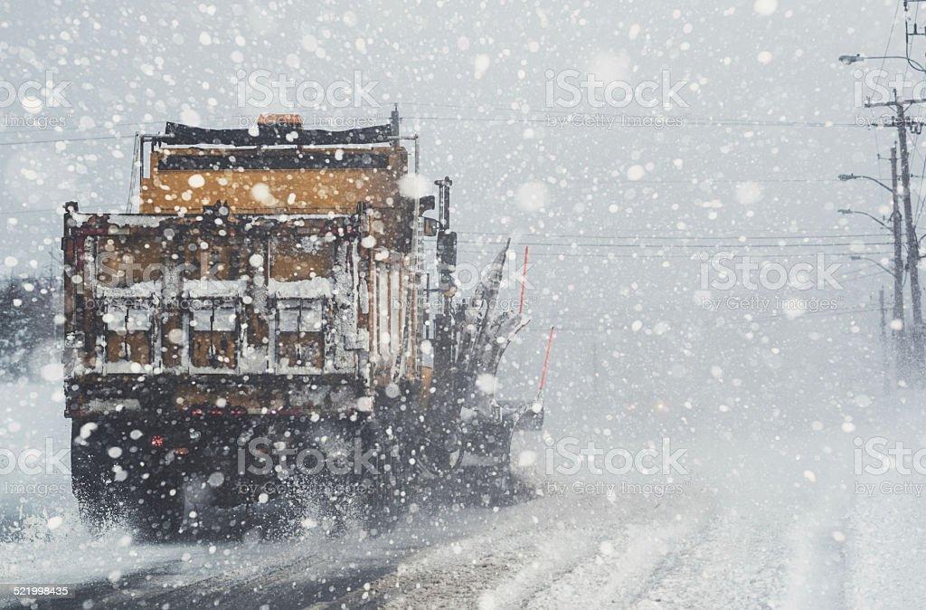 Snowplow Clearing Street stock photo