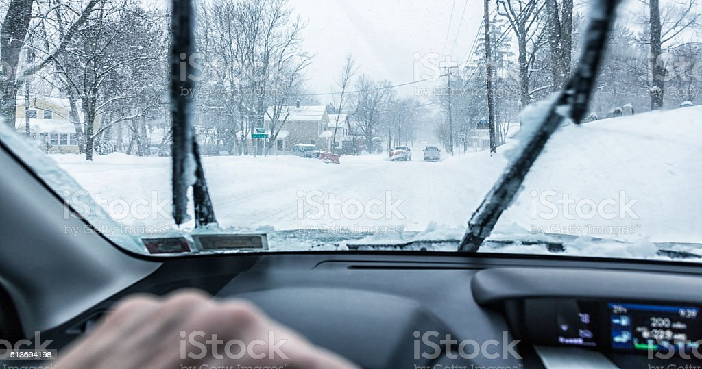 Snowplow Pickup Trucks Intersection on Winter Blizzard Snow Street stock photo