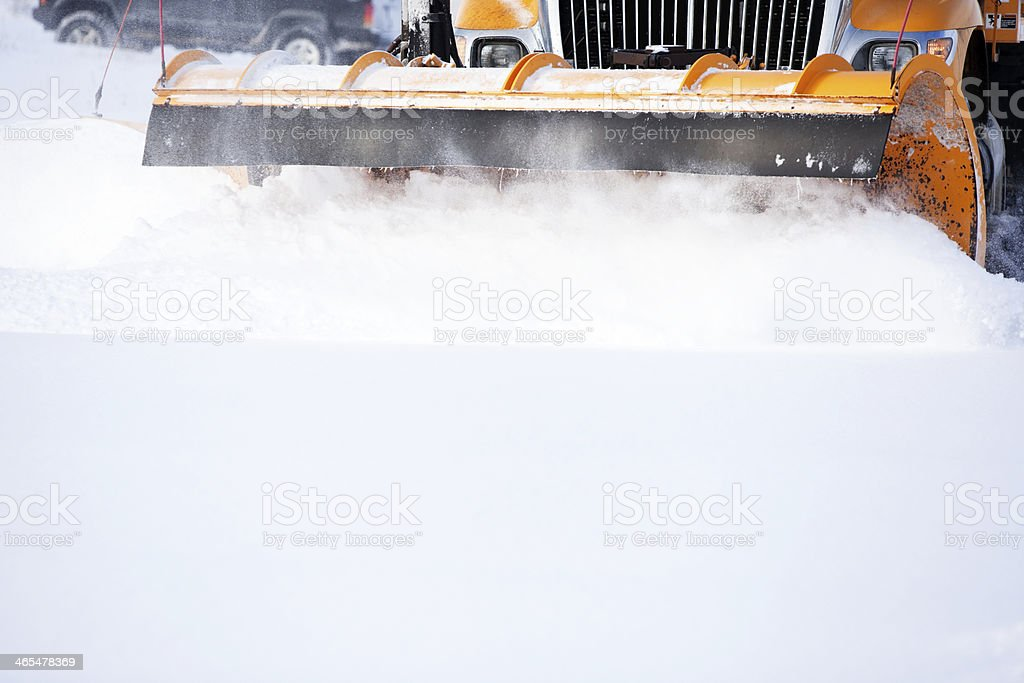 Snowplow Plowing Snow from City Street stock photo