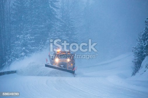 536171925 istock photo Snowplow plowing the highway during snow storm. 536049293