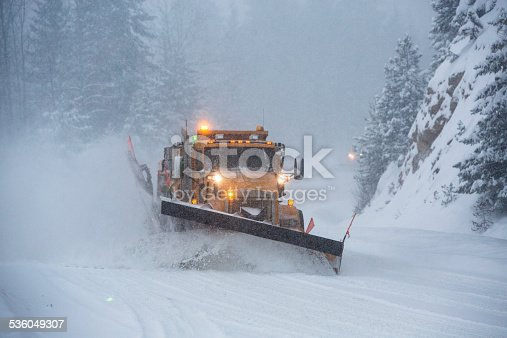536171925 istock photo Snowplow plowing the highway during snow storm. 536049307