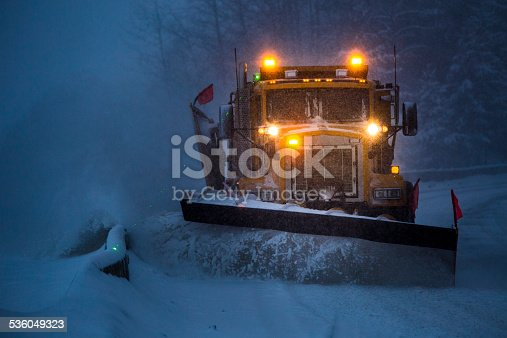 536171925 istock photo Snowplow plowing the highway during snow storm. 536049323