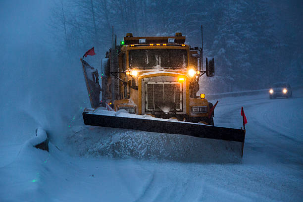 snowplow plowing the highway during snow storm. - 2015 stok fotoğraflar ve resimler