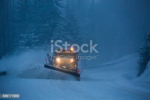 536171925 istock photo Snowplow plowing the highway during snow storm. 536171933