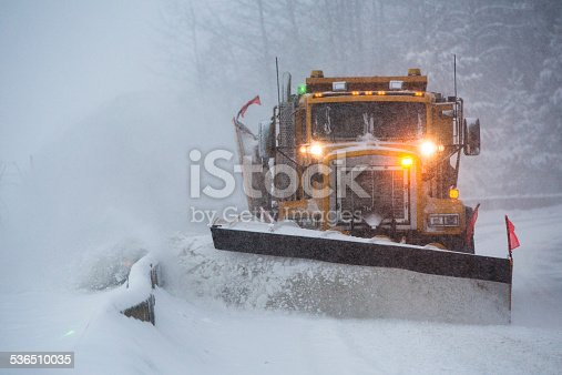 istock Snowplow plowing the highway during snow storm. 536510035
