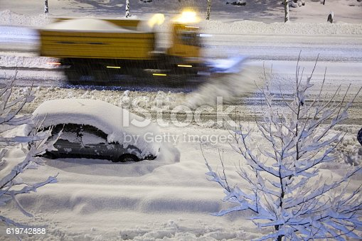 536171925 istock photo Snowplow removing new snow at night 619742888