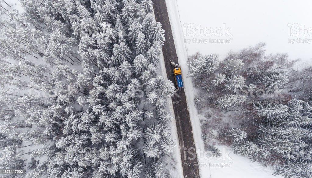 Snowplow truck maintaining road stock photo