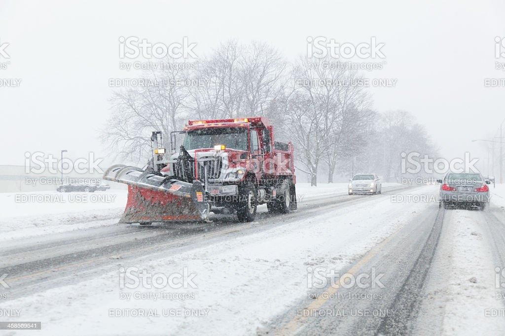 Snowplow Truck Working During Blizzard stock photo