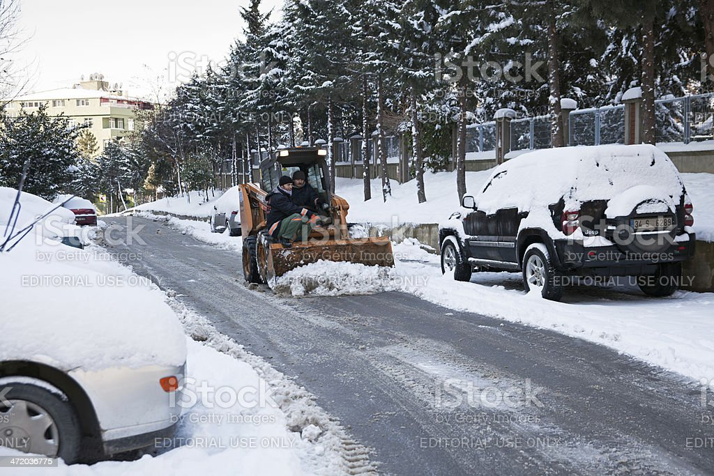 Snowplow Vehicle and Workers stock photo